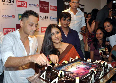 Vidya Balan cutting with special cake with Sujoy Ghosh on occassion of the DVD launch of their film KAHANI at Diesel Store in Mumbai photo