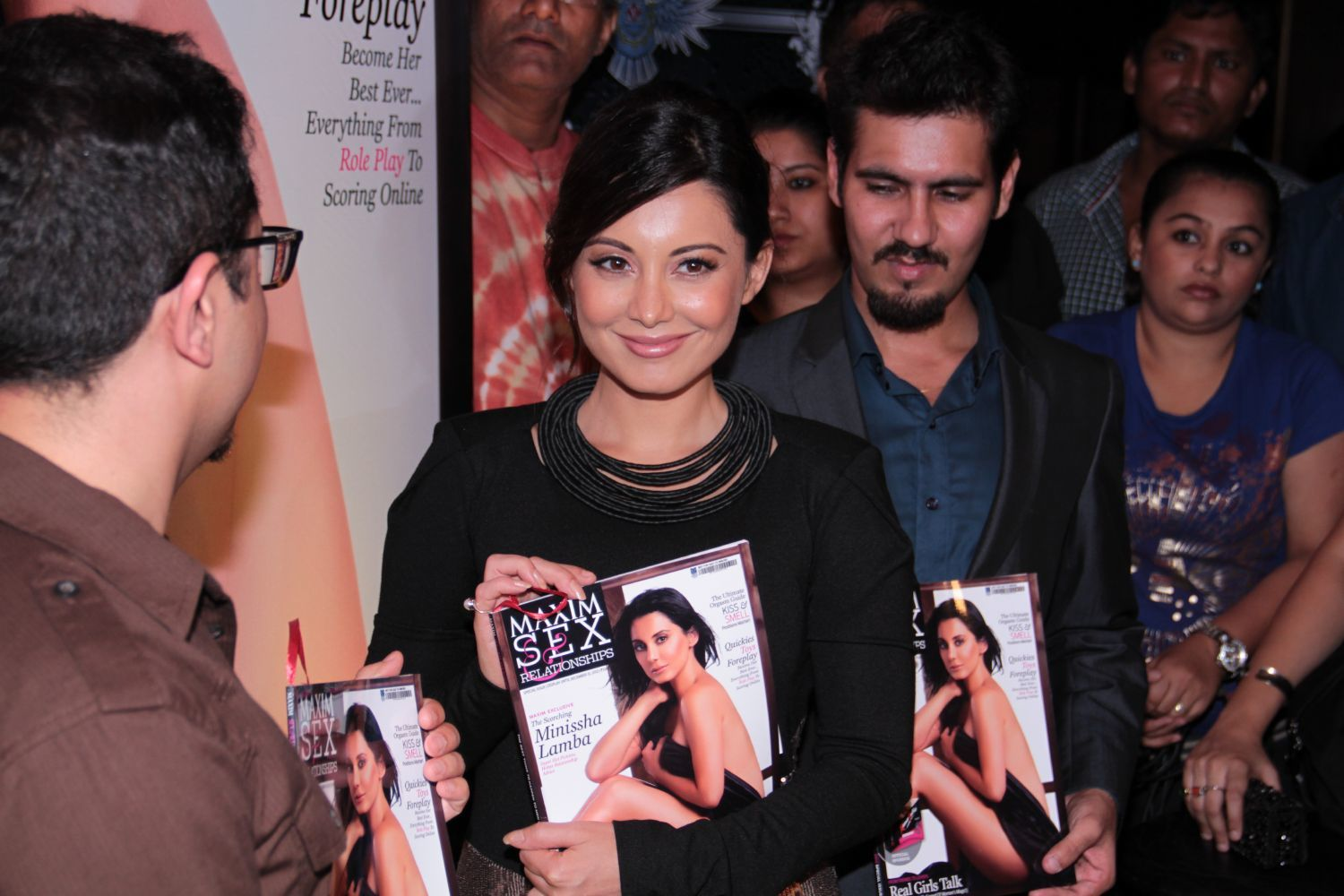 Minissha Lamba posing with magazine MAXIM SEX RELATIONSHIPS at its cover ...