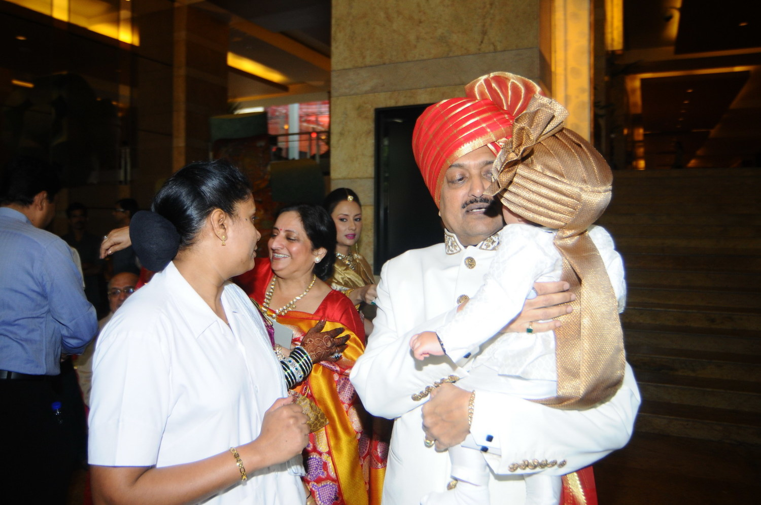 Union Minister Vilasrao Deshmukh Playing With His Grandson At The Wedding Ceremony Of His Son